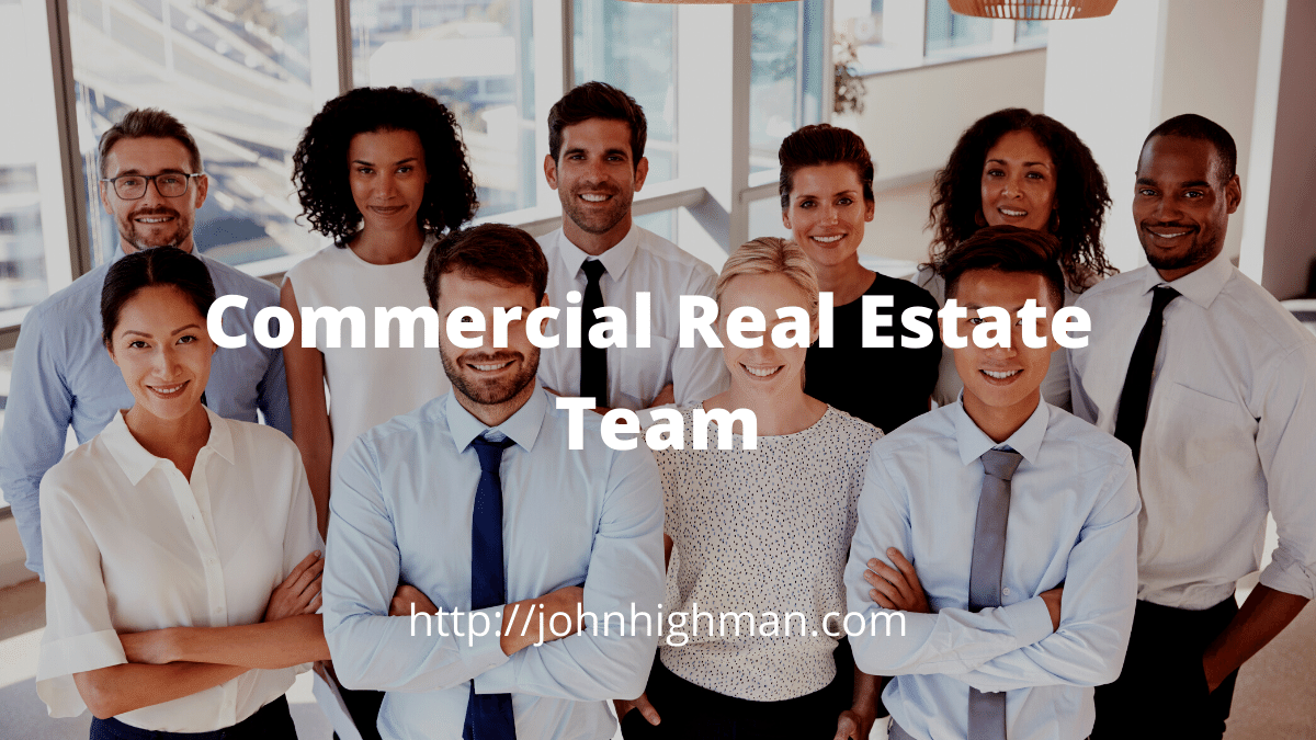commercial real estate team standing together